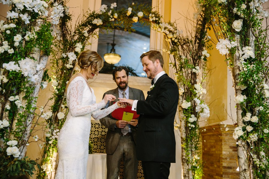exchanging of the ring at winter boston public library wedding