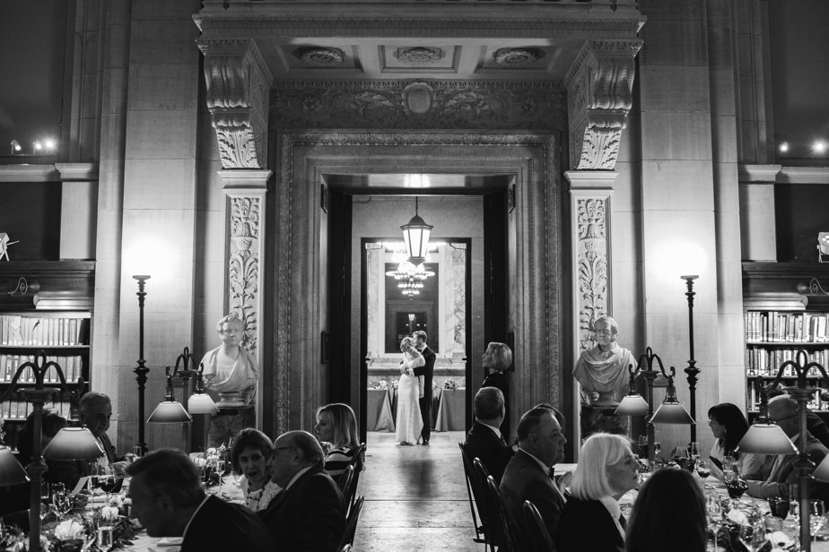 sneak a kiss at boston public library wedding